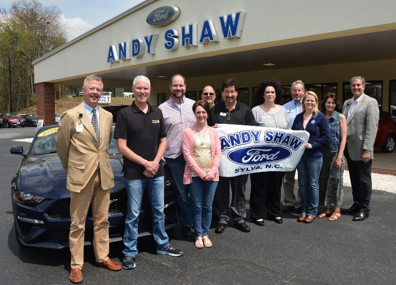 people standing at andy shaw ford