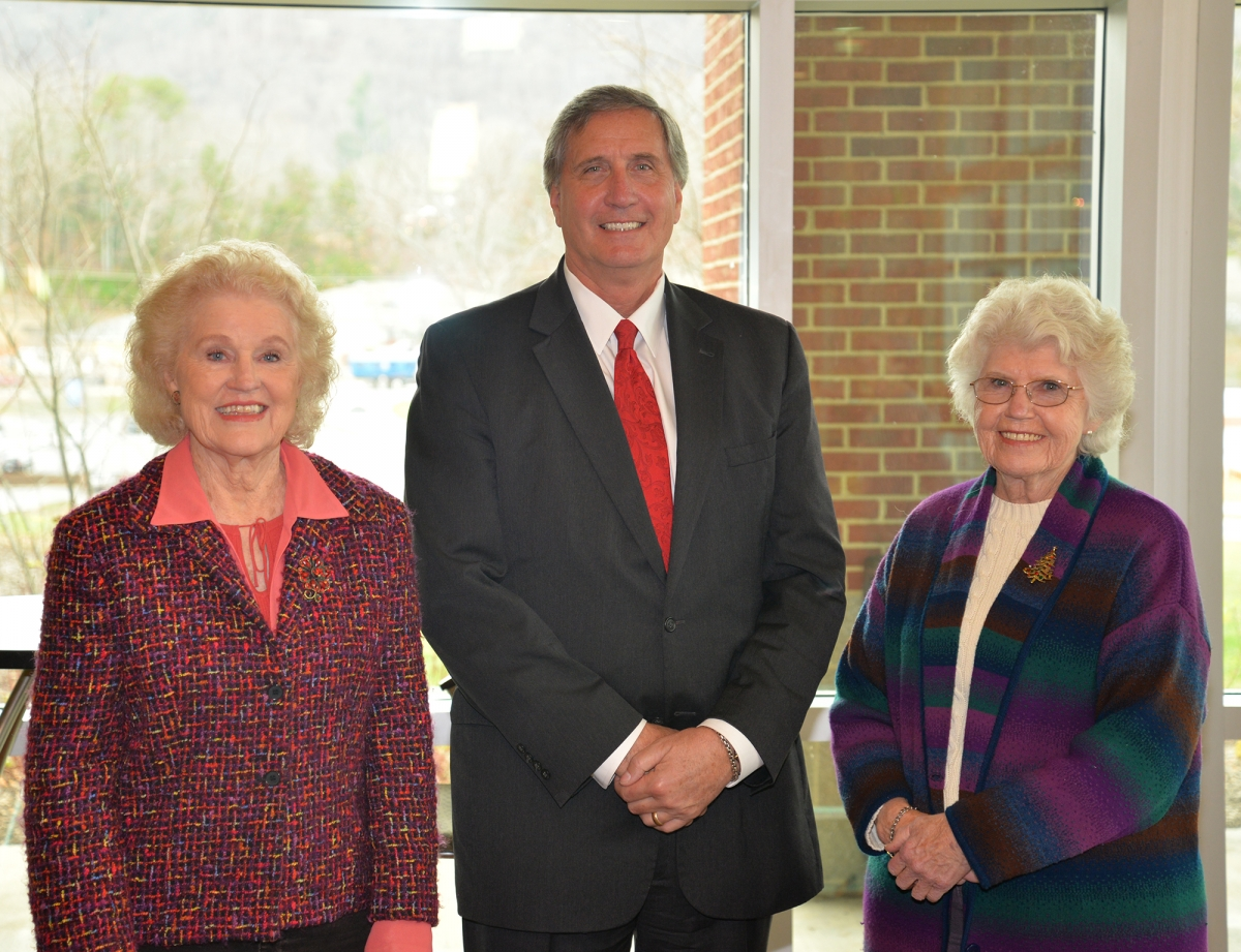 Two ladies and well-dressed man pose for photo inside a building on SCC's Jackson Campus