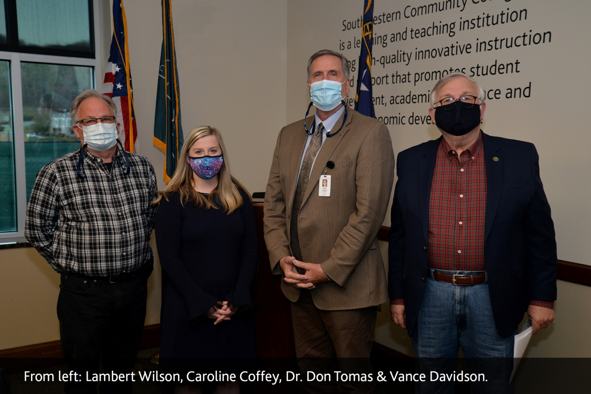 Caroline Coffey, student representative, stands beside Lambert Wilson, Dr. Don Tomas and Vance Davidson.