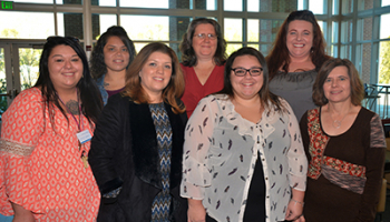 SCC medical assisting graduates pose for picture at pinning ceremony on Dec. 13.