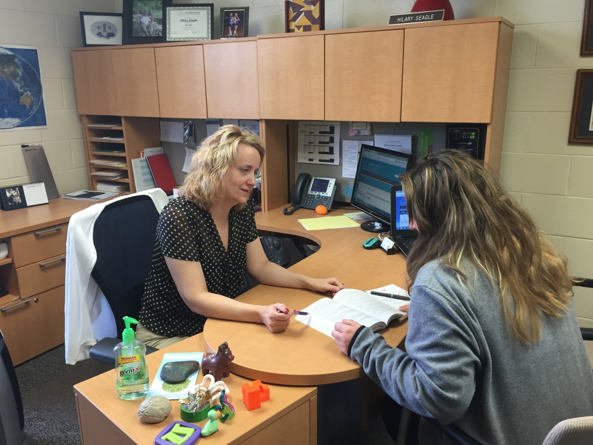 Photo of SCC faculty member advising a student in her office.